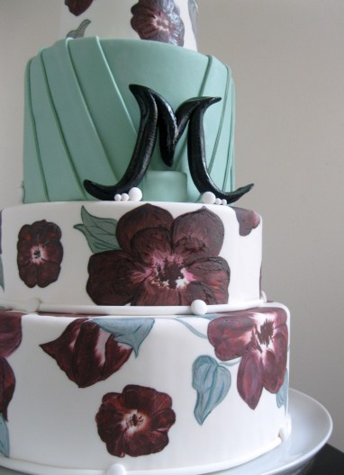 Inspiration for cake designs can come from the most common of items, even a quilt. Mix that with a little pleat dress detail and this is the end result. Something pretty.